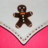 Détail Petit plat cœur en porcelaine peinte à la main décor bonhomme en pain d'épices